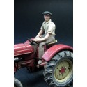 Man driving his tractor