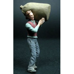 Man with a potato bag on his shoulder