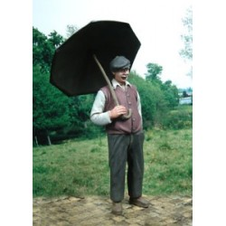 Man under his open umbrella